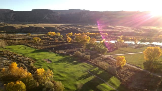 evening drone footage of luxury golf course at dusk in the fall - colorado stock videos & royalty-free footage