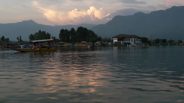 evening dusk view across the dal lake,  viewed from a traditional tourist row boat in srinagar, jammu & kashmir kashmir - jammu e kashmir video stock e b–roll
