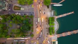 evening illumination zurich center riverside traffic square down view aerial panorama 4k time lapse switzerland