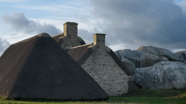 evening light at meneham-brittany. - thatched roof stock videos & royalty-free footage
