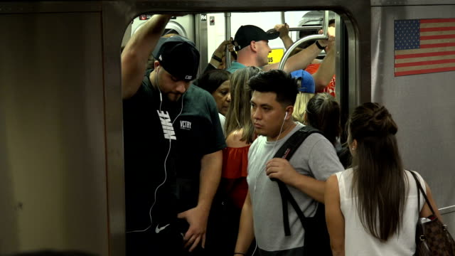 evening rush hour, subway #7 train, grand central station, nyc - underground stock videos & royalty-free footage