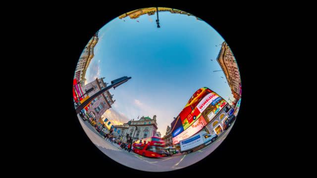 evening rush hour traffic in piccadilly circus in london. - fish eye lens stock videos & royalty-free footage