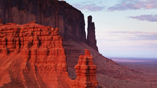 evening shadows in monument valley - aerial shot - navajo reservation stock videos and b-roll footage