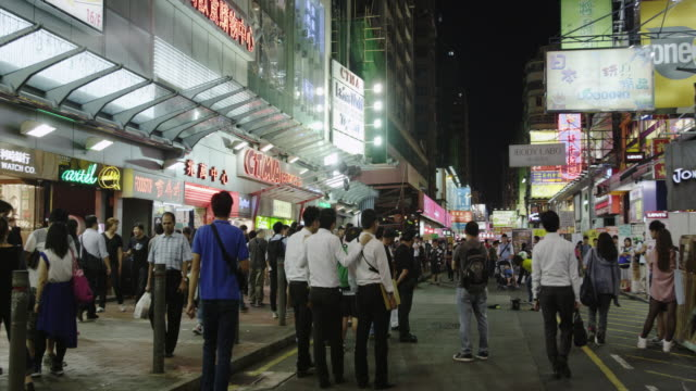 evening street scene in mong kok shopping district - mong kok stock videos & royalty-free footage