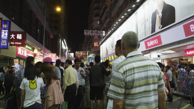 evening street scene in mong kok shopping district - western script stock videos & royalty-free footage