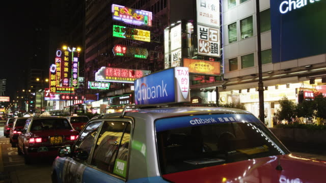 evening street scene in mong kok shopping district - mong kok stock videos and b-roll footage