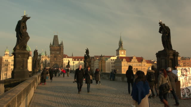 evening strollers on charles bridge in prague - czech culture stock videos and b-roll footage