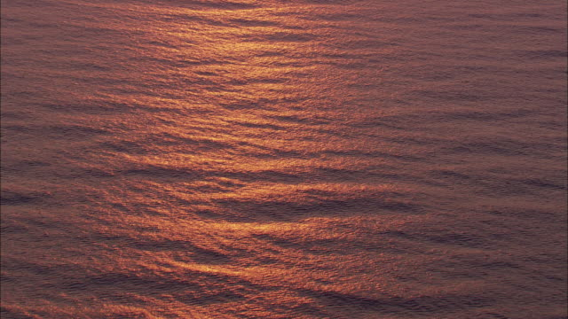 aerial ws evening sunlight reflecting in sea water, indian ocean, near durban, kwazulu natal, south africa - durban stock videos and b-roll footage
