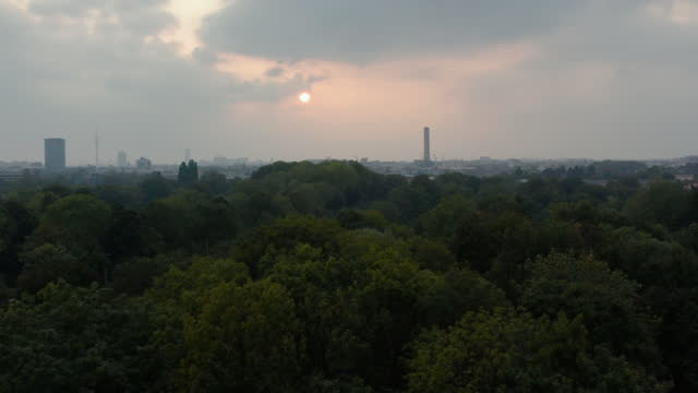as evening sunset with obscured sun in munich, germany - wop productions stock-videos und b-roll-filmmaterial