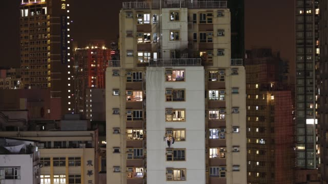 vídeos y material grabado en eventos de stock de evening timelapse of illuminated residential buildings in the sheung wan district of hong kong on monday nov24 2014 - sheung wan