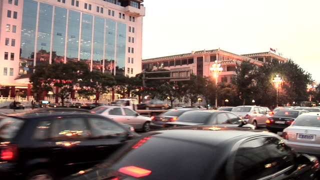 ws ts evening traffic on dong chang'an jie near tiananmen square at dusk/ beijing, china - tracking shot stock videos & royalty-free footage