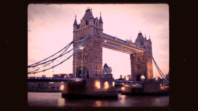 evening traffic on tower bridge in london shot in old 8mm film camera simulation. - hd format stock videos & royalty-free footage