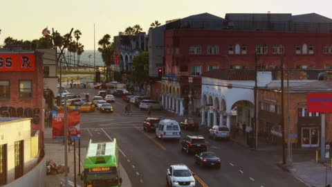 evening traffic under the venice sign - zoom out stock videos & royalty-free footage