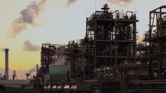 ms evening view of chemical factory / kawasaki, kanagawa, japan    - combustibile fossile video stock e b–roll