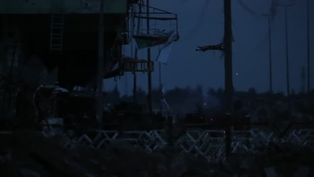 Evening views of fighting between Iraqi Army troops and Islamic State militants in western Mosul