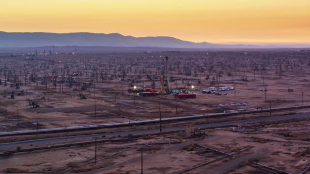 Evening Work in South Belridge Oil Field in Kern County, California - Drone Shot