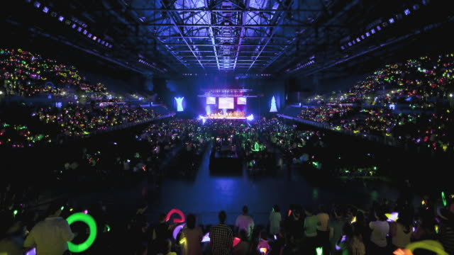 WS T/L Event center filling up with people for glow stick carols event / Auckland, Auckland, New Zealand