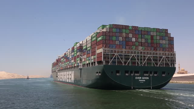 ever given container ship after being released by the suez canal authority, in ismailia, egypt, on wednesday, july 7, 2021. the giant japanese-owned... - suezkanalen bildbanksvideor och videomaterial från bakom kulisserna