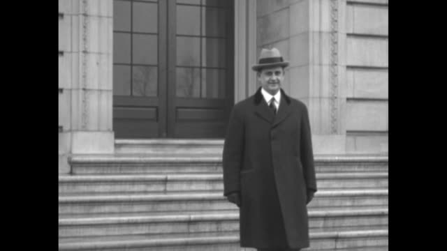 everett sanders new secretary to pres calvin coolidge leaves building poses and removes his hat / note exact day not known - coolidge calvin stock videos & royalty-free footage