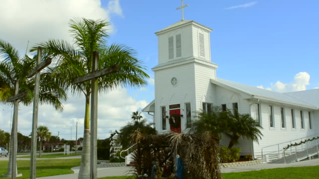 everglades city florida everglades community church founded in 1926 in small village steeple and palms with red door - steeple stock videos & royalty-free footage