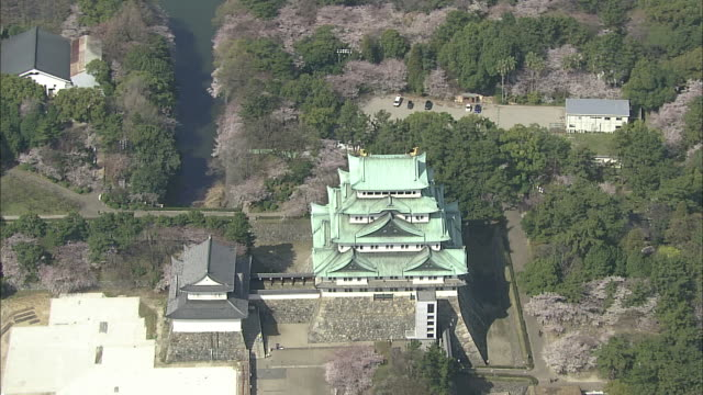 Evergreen trees surround the property of Nagoya Castle.