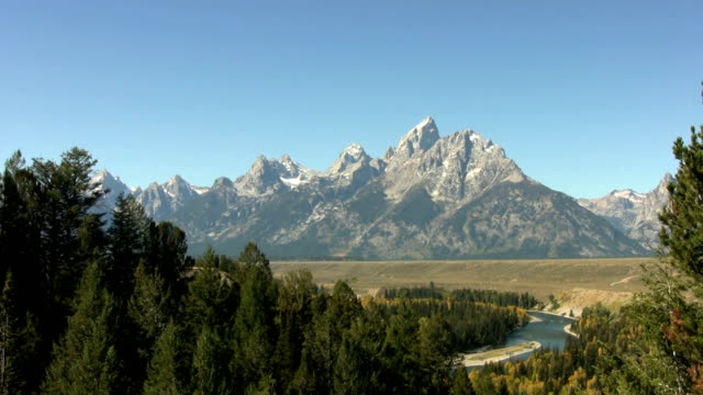 Evergreens line the Snake River Valley