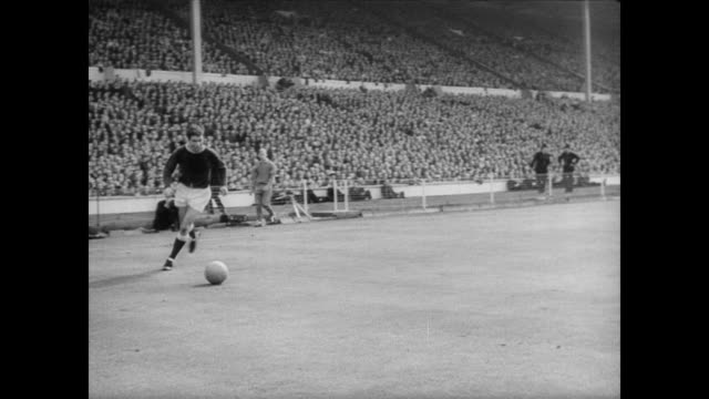 everton and sheffield wednesday play in cup final match at wembley stadium / second half of match / massive crowd surges forward cheering / man runs... - 1966 stock-videos und b-roll-filmmaterial