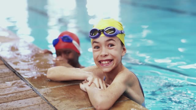 every champion had to start somewhere - girl swimming costume stock videos & royalty-free footage