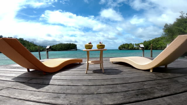 every couple deserves to go on a romantic getaway - deck chair stock videos & royalty-free footage