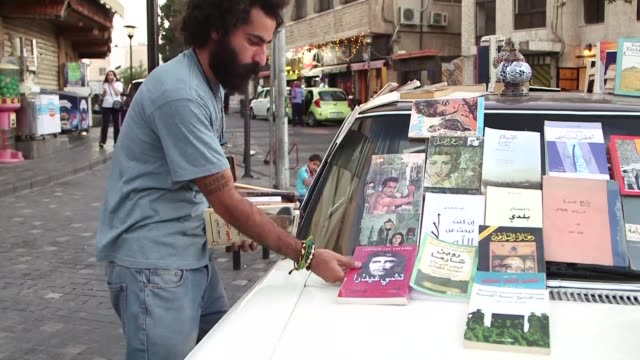 Every day Ghaith Bahdousheh sets up more than 400 books in various languages on his old Mercedes 200 nicknamed Nancy and travels all over the...