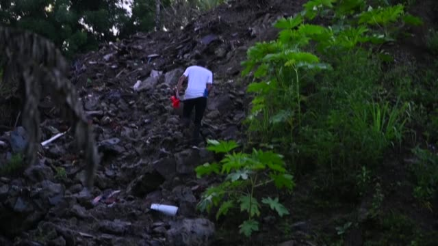 every day, salvadoran college students from the northern state of el tigre, a rural area close to guatemala's border, climb a mountain of trash,... - symmetry stock videos & royalty-free footage