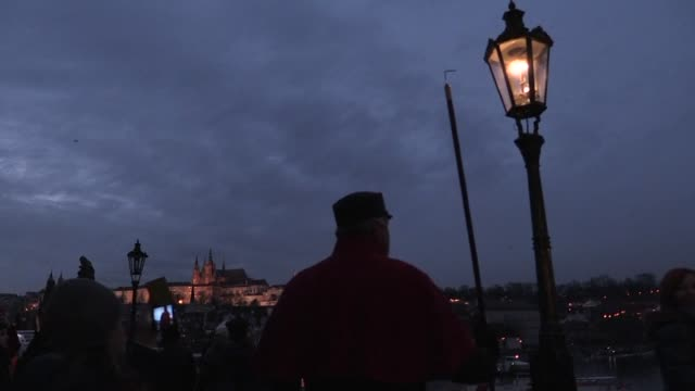 every day since the end of november jan zakovec and his colleague have been lighting historic gas lamps on prague's picturesque charles bridge... - charles bridge stock videos & royalty-free footage