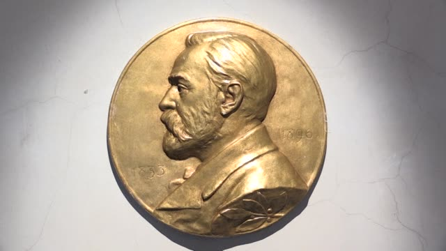 every year for the last 114 years nobel prizes have been handed out for pioneering work in the fields of peace literature, medicine, physics... - literature stock videos & royalty-free footage