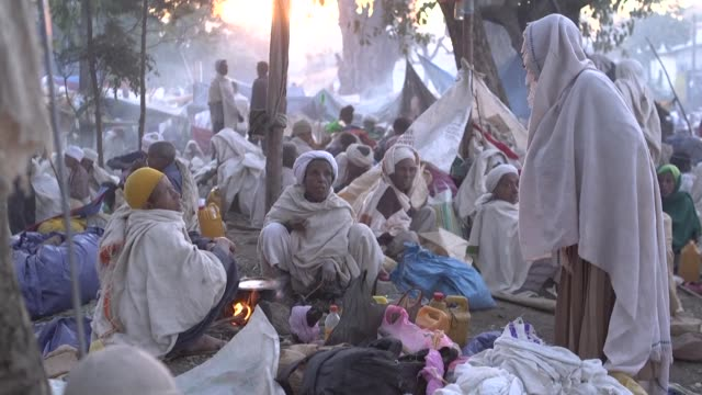 every year tens of thousands of ethiopian pilgrims from across the country come to lalibela's rock hewn churches to celebrate christmas - christianity stock videos & royalty-free footage