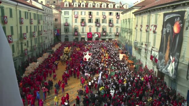 Every year the Carnival of Ivrea in the Piedmont region of Italy revives a historic battle where teams of different districts of the city battle...