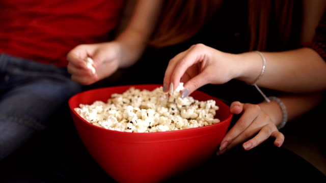 Everybody is eating popcorns when watching movies