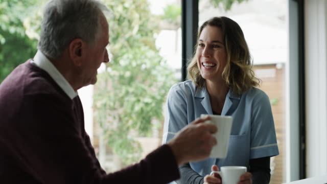everybody loves coffee and a chat - healthcare worker stock videos & royalty-free footage