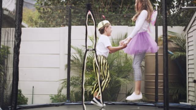 stockvideo's en b-roll-footage met elke dag is een sprong met een trampoline rond - trampoline