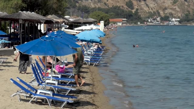 everyday life at the sandy beach of agia triada near thessaloniki in greece agia triada is a summer tourist destination for locals and foreign... - thessalonika stock videos & royalty-free footage