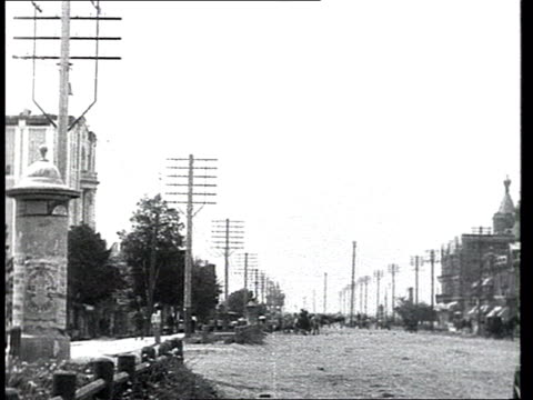 everyday life in a small provincial town in prerevolutionary russia electric poles along streets wooden houses horse drawn carts most probably the... - 1913 stock-videos und b-roll-filmmaterial
