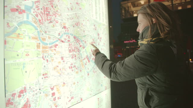 Everyday life in Berlin: woman checking a map