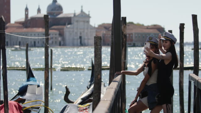 everyday life of a summer day in venezia full of tourists - japanese ethnicity stock videos & royalty-free footage