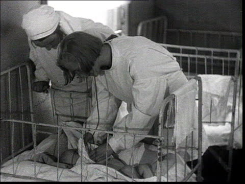 everyday life of workers who build the new factories pioneers of soviet industrialization ws of babies dormitory nurse examine baby babies having... - 1930 stock-videos und b-roll-filmmaterial