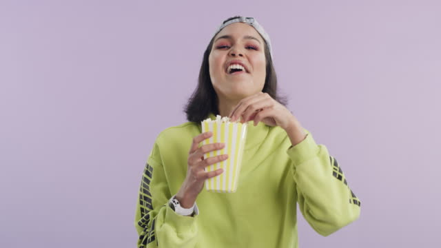 everything is better with some popcorn - cool attitude stock videos & royalty-free footage