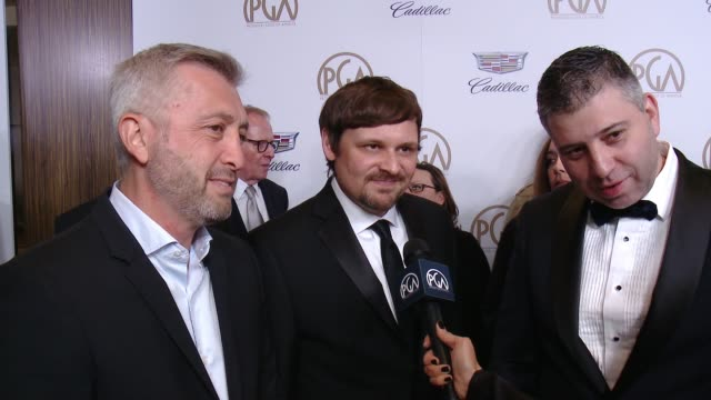 INTERVIEW Evgeny Afineevsky Aaron I Butler and Den Tolmor at 29th Annual Producers Guild Awards presented by Cadillac at The Beverly Hilton Hotel on...
