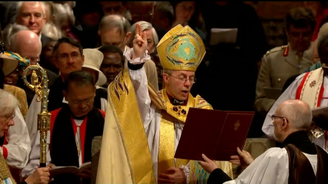 evidence found of church of england conducting blessings for gay couples; lib kent: canterbury: canterbury cathedral: int welby reading prayer during... - anglican stock videos & royalty-free footage