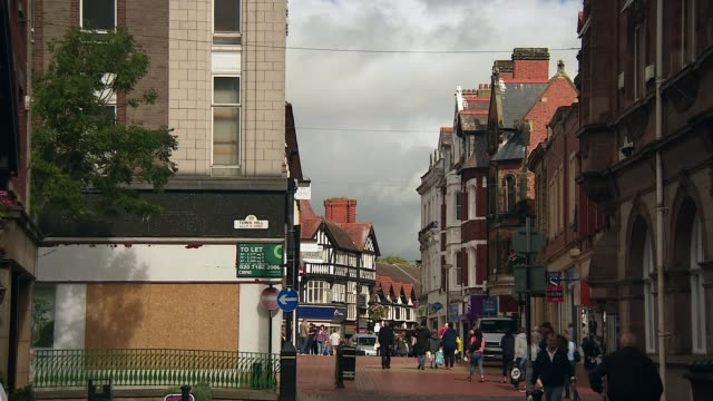 evidence that dangerous drug spice is spreading to smaller towns in uk; police office speaking to man general view wrexham shopping street steve... - spice stock videos & royalty-free footage