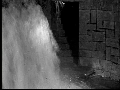 1925 ms b/w evil man falling into water, door closing - trapped stock videos & royalty-free footage