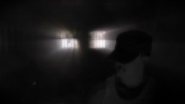 evil man in  darkness hd - prison window stock videos & royalty-free footage