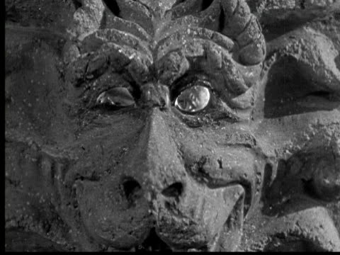 1925 cu b/w evil man looking through curved lion's eyes - evil stock videos & royalty-free footage